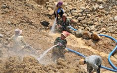 Sapphire mining near Pailin using high-pressure water to turn the gem rich gravels into mud. The mud will be then processed using the fact t...