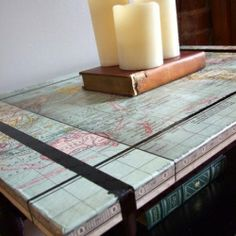 Re-paint an old table and cover with a map for an easy furniture makeover.