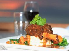 Lamb Shank...anyone? *braised lamb shank with creamy tasty mash, fresh lightly steamed veggies and refreshing mint sauce accompanied with a glass of red...how marvellous! Come dine with us! https://www.smugglersbeachfiji.com/wp-content/uploads/2016/07/Current-Menu2.pdf