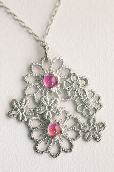 An elegant silver crochet pendant with personalized sapphires. The jewellery design from Brigitte Adolph is an unique an really beautiful way to wear all the beloved ones with you. Are You The One, Sapphire, Jewelry Design, Pendants, Gemstones, Jewellery, Elegant, Crochet, Unique