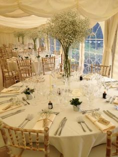 Gypsophilia table decorations at a marquee wedding