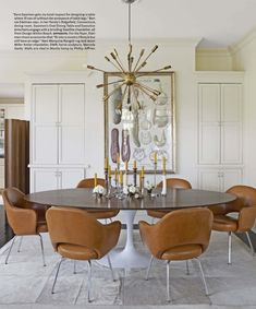 Sputnik lamp, Saarinen round pedestal dining table and reupholstered camel colored leather dining chairs... SWOON