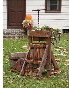 Cider press. Sure brings back memories of hot autumn days with sticky sweet cider and watch out for yellow jackets!