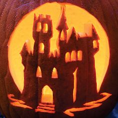 31 Halloween Pumpkin Carving Ideas | Haunted Castle Pumpkin | SouthernLiving.com