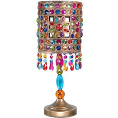 @Overstock - Multicolor Jewel Flower Table Lamp (China) - This wonderful casual style lamp has a faux crystal inlaid cylinder shade and hanging bauble fringe. The robust, well-crafted lamp design includes base, harp, shade and finial configuration.    http://www.overstock.com/Worldstock-Fair-Trade/Multicolor-Jewel-Flower-Table-Lamp-China/7627180/product.html?CID=214117  $118.00