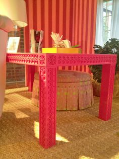 This gorgeous (and, no doubt, pricey) desk is by Lilly Pulitzer Home, but why not create one's own with a simple parson's table and o'verlays?