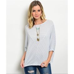 Striped Dolman Sleeved Shirt This light blue and cream striped shirt with crotchet lace detailing down the back of it is a perfect pair with jeans or leggings to add a causal yet girly look to any outfit. Light weight knit material. Made of a cotton blend. Sizes S,M Tops Blouses