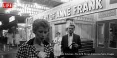 The former Barbara Ledermann, now Mrs. Martin Rodbell, debating whether to see The Diary of Anne Frank movie while outside the theater in 1959.