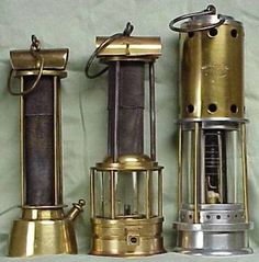Shown here are a Davy-style Lamp, un-bonneted Clanny-style Lamp and a bonneted Clanny-style Lamp with a Beard-Mackey Sight Indicator to measure the percentage of methane gas present. The invention of a reliable flame safety lamp, along with improved ventilation systems and practices were a major boon to the coal mining industry world-wide.