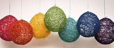 Dip yarn in watered down glue, wrap around balloon and pop balloon when dry... I love these!