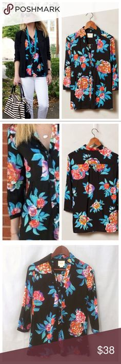"""Anthropologie Woodland Walk Floral Buttondown Sz 0 Anthropologie Woodland Walk Floral Buttondown  • Sz 0  • EUC, excellent pre-loved condition, no signs of wear, like new • Full length button down • Three quarter length sleeve - 12"""" inseam - one button cuff • Relaxed peplum shape • Black background with flowers in colors of bright blues, red, purple, and yellow • Measurements taken with shirt flat • 17"""" bust • 14.25"""" shoulders • 26"""" length Anthropologie Tops Button Down Shirts"""