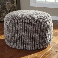 Signature Design by Ashley Achiles Pouf | Hayneedle