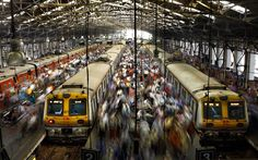 Commuters get off trains at the Church Gate railway station in Mumbai Indian Railway Train, Train Journey, City That Never Sleeps, Natural Disasters, Far Away, Life Skills, The Locals, Mumbai, Street View