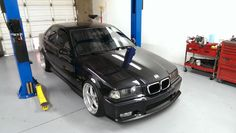 Black BMW e36 sedan on 18'' OZ Mito II wheels