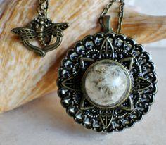 Dandelion box locket, round locket with music box inside, in bronze with dandelion wishes encased in glass