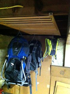 use an old crib side-rail screwed onto the joists in the basement or rafters in garage to make a rack for hanging our hiking gear. Please like, repin and share! Thanks :)