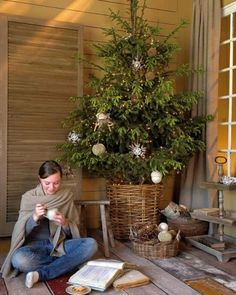 love the idea of a smaller fresh tree in a basket for christmas