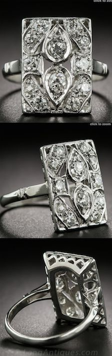 **Platinum Diamond Dinner Ring, A rectangular plaque, rendered in platinum, centering an a pair of back-to-back diamond-set teardrops and studded with ten more bright-white glittering round diamonds makes for a stunning and sophisticated Jazz-Age sparkler - circa 1920s.