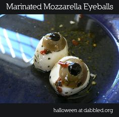 Halloween Food: Dot's Mozzarella Eyeballs - most fresh mozarella contains citric acid, can use cream cheese or other white cheese as well.