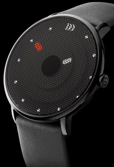 Danish Design Note: The watch is ugly, but the idea to print on the inner side of the glass is cool.