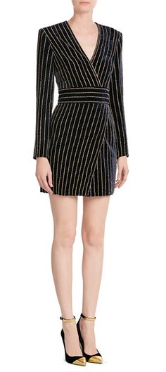 Balmain's black velvet dress is embellished with gold-tone beads for added texture and an instant dose of glamour. The V-neckline and short length keep it contemporary and super sensual #Stylebop
