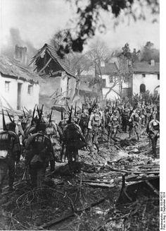 WW1 German infantry in damaged village, Prussia, Battle of Tannenberg, 1914.