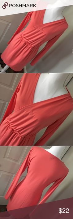 """TopShop Size 8 LS Coral Faux Wrap Dress EUC Absolutely gorgeous coral dress from TopShop featuring long sleeves and a faux wrap style. It is in EUC with no rips, tears or stains and is a size 8. Fabric is 95% poly, 5% elastane and my cousin bought the dress online from TopShop. Length is 37"""" and waist is 15"""" across flat unstretched. Thank you for looking! ☺️ 🚫trades 🚫 lowball offers Topshop Dresses"""
