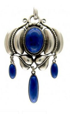 Theadore Fahrner Lapis Lazuli Brooch Art Deco (1920-1935 Theadore Fahrner was a German jewellery designer (1868-1929) who anticipated the geometric linear forms of the Art Deco period with his range of affordable Art Jewellery in silver, enamel and panels of hardstone set in borders of marcasite. This pendant is a lovely example of his work.