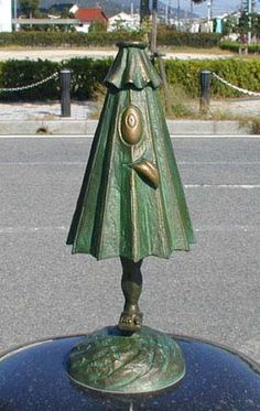 Kasa Obake statue ... yokai in Japan. Kasa Obake or Karakasa in particular are Spirits of Kasa (umbrellas) that reach the century milestone. They are typically portrayed with one eye, a long tongue protruding from an open mouth, and a single foot, generally wearing a geta.