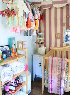Bohemian style child's room- hanging the clothes in plain view is a great way to deal with limited closet space.