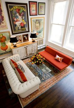 I love this eclectic living room. White, black and red but with so many patterns and textures.