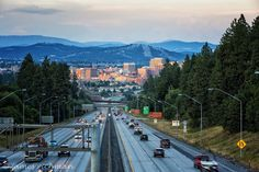 ~ City of Spokane ~ for many that live in Spokane, this view of Spokane from I90 heading East is a favorite because it means you're nearly home.  Photo courtesy of James Richman Photography