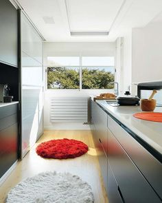 Sliding doors to hide kitchen appliances.. really like this galley kitchen