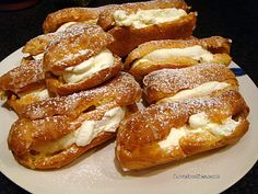 Cream Filled Chocolate Eclairs - Easy to make and always great anytime!  Lovefoodies