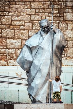 https://flic.kr/p/JfU5mS | IMG_7370.JPG | A kid having a staring contest with the sculpture of Pope John Paul II in front of the Sacred Heart Cathedral in Sarajevo, Bosnia-Herzegovina