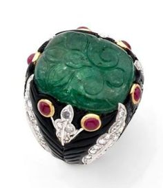 A DIAMOND, EMERALD, ONYX AND RUBY WHITE GOLD RING