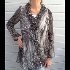 Nice Blouse PRICE DROPPED Beautifully shaped animal print soft polyester blouse.  Some pleating around flared bottom really adds a  come-hither look.  Lovely with slinky skirt or pants.  Cocktail party or Sunday brunch. Sunny Leigh Tops Blouses