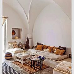 Boho living room with arched ceilings