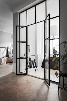 Living Room Monochrome home with a glass partition via Coco Lapine Design Modern Interiors Interior Architecture Minimalist Contemporary Interior Design Modern Livin.