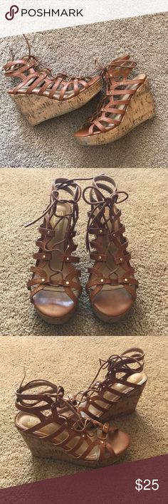 brown and gold wedges size 7 brown and gold wedges size 7 in gently used condition but not obvious flaws other than wear on bottoms. Cute gold round studs and ties at top. These are platform heel wedges and perfect with a dress or jeans for the spring and summer! Shoes Wedges