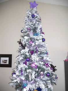 Flocked Christmas tree with purple decor from my personal home. Flocked Christmas Trees, Beautiful Christmas Trees, Christmas Scenes, Xmas Tree, Christmas Tree Decorations, Christmas Lights, Christmas Holidays, Different Holidays, All Things Purple