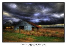 old barn at sunrise in South GA ... looks like storm.  02/05/10 by Marvin Foran Photography
