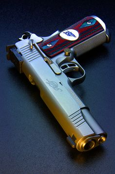 I am not a gun person but this looks like a pretty cool gun..... Kimber by ZORIN DENU, via Flickr
