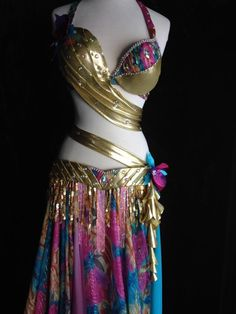 """For sale, C cup, Asking $500 OBO gold lycra silk chiffon print taffeta flower accents. Skirt is multiple layers of wired chiffon. Brand new! Comes with headband and arm bands.Underbust 38"""", C cup, 6 1/2"""" high, 8 1/2"""" diagonal, 8"""" horizontal. Belt is 46"""" long but can be made smaller. The fringe is 5 1/2"""" holographic sequins, 8"""" glass beads in pink. Skirt is turquoise, pink, and patterned chiffon and is 35"""" long. Willing to take payments."""