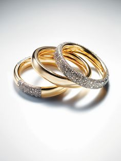 "Pomellato ""Tango"" collection bangles in 18-karat rose gold with brown diamonds."