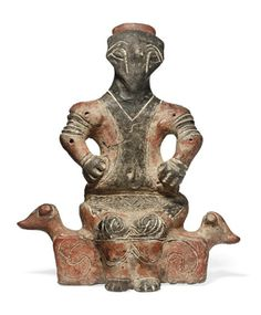 Vinca terracotta seated male figure, neolithic, circa 5th millenium B.C. - so say the experts - but that is clearly not a human face