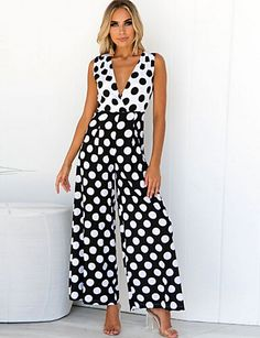 Pop in polka dots! It mixes back and white polka prints in a bold and fresh way! It's a sleeveless design with a V-neck.