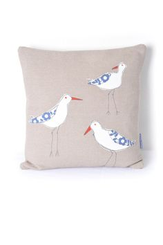 Coastal Decor. Coastal cushions. Coastal Pillows. Brighten up a corner of your home with this fabulous Oystercatchers cushion. The central motifs have been appliquéd using free motion machine embroidery stitch, reminiscent of softly drawn pencil lines. With their characteristic red-orange beaks these quirky wading birds are sure to bring a touch of the coast wherever they go. These are one of my favourite birds, often to be seen on early morning walks along the Topsham estuary. Product…