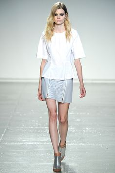 Sara in theWhite Cotton Shirt and Gray leather Perforated Skirt #SS14