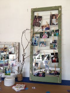 What a creative way to showcase pictures - old windows strung with twine.